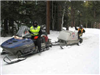 Snowmobile ambulance and trailer