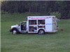 Response ambulance in grassy area