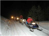 Search and Rescue team on snowmobiles in snow