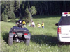 All terain vehicle (ATV) in grassy area
